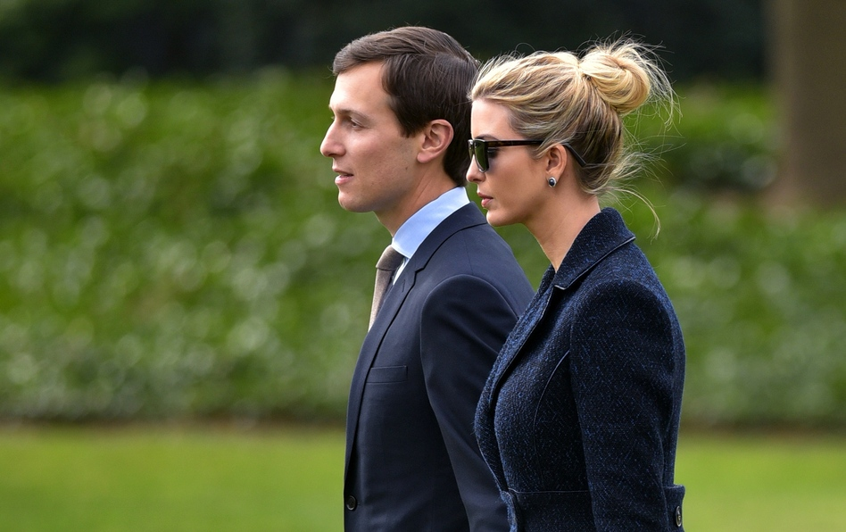 White House senior adviser Jared Kushner and his wife, Ivanka Trump, walk toward Marine One at the White House on March 3. A watchdog group says that Kushner should recuse himself from certain duties since he is President Trump's son-in-law and has potentially conflicting business ties. (Mandel Ngan/AFP/Getty Images)
