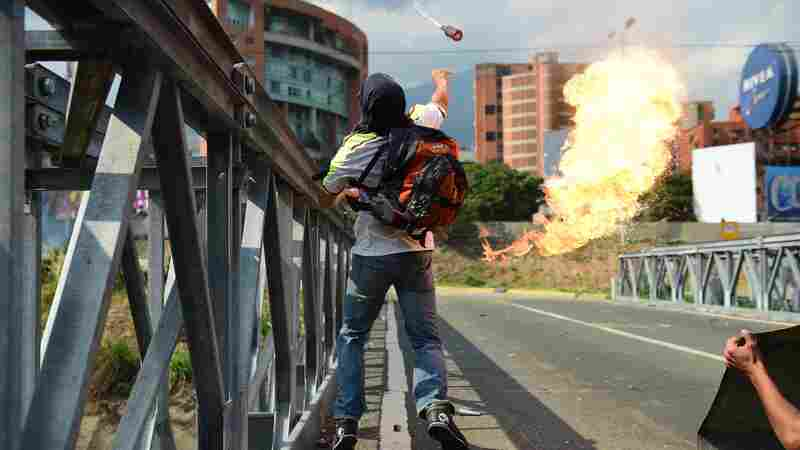 Dueling Rallies Rack Caracas After Death Toll Inches Toward 30 In Venezuela