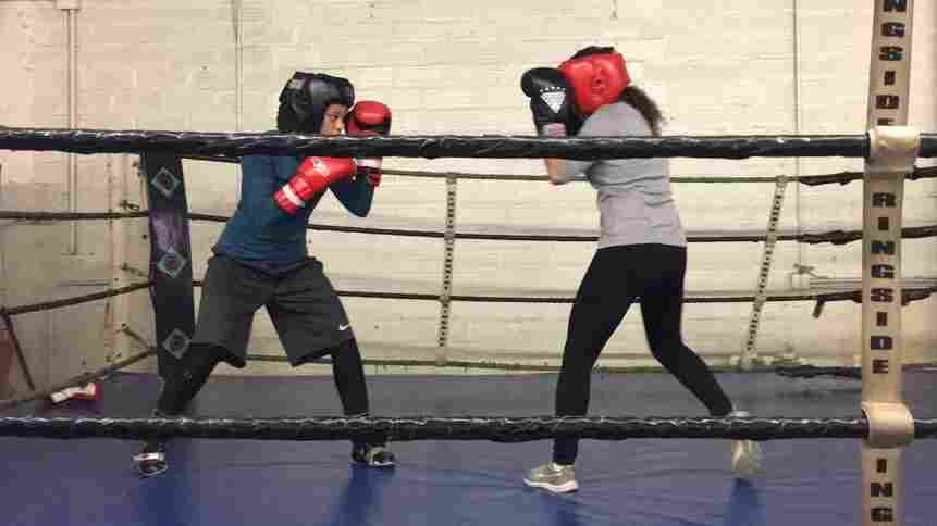 Wearing A Hijab, A Young Muslim Boxer Enters The Ring