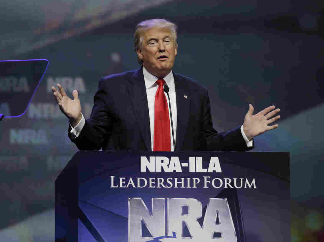 Trump addresses cheering crowd at NRA convention