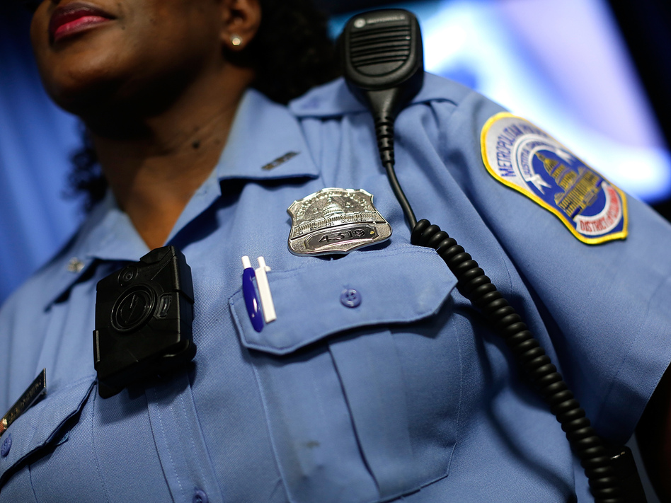 A Washington, D.C., Metropolitan Police officer wears a camera during a news conference in 2014. (Win McNamee/Getty Images)