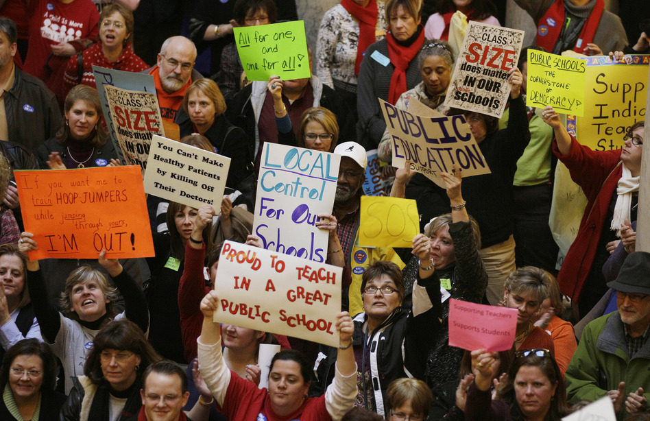 Teachers rallied at the Statehouse in Indianapolis in 2011 to protest Gov. Mitch Daniels' attempts to curb collective bargaining, implement merit pay and create a voucher system that would send taxpayer money to private schools. (Darron Cummings/AP)