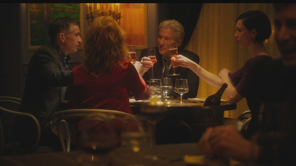"""Go on, do your Michael Caine!"": Paul (Steve Coogan), Claire (Laura Linney), Stan (Richard Gere) and Katelyn (Rebecca Hall) get toasted in The Dinner."