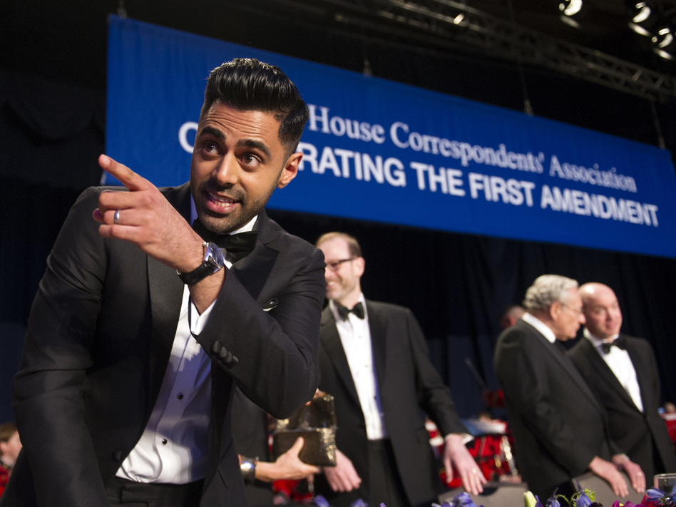 <em>The Daily Show</em> correspondent Hasan Minhaj stands at the head table during the White House Correspondents' Association Dinner in Washington on Saturday. (Cliff Owen/AP)