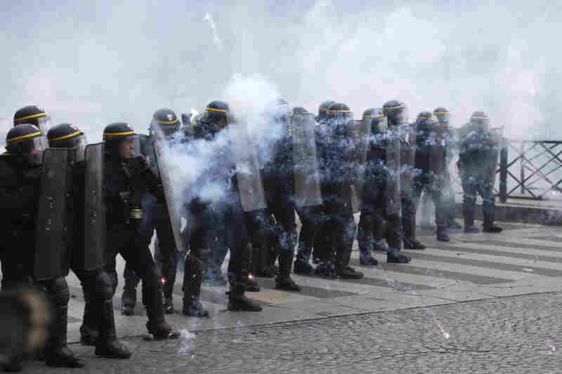 Riot police officers take position as they face demonstrators during the May Day demonstration in Paris. Paris police reportedly fired tear gas at rowdy protesters on the sidelines of the May Day workers march.