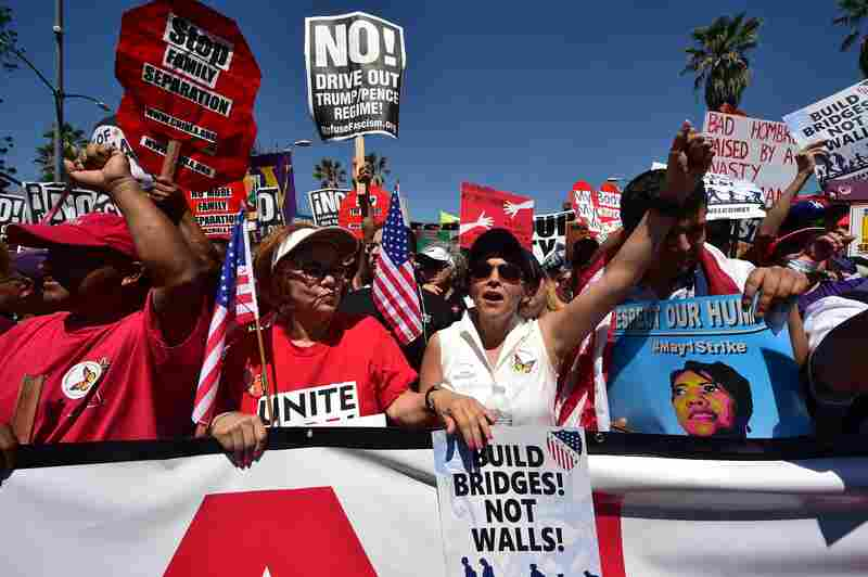 Protesters march against President Trump's immigration policy in Los Angeles on Monday, where tens of thousands are expected to take to the streets on May Day.
