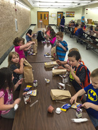 The kids in the after-school program get a healthy snack before they go to classes and other activities.