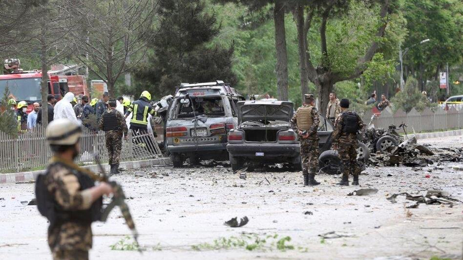 Security forces inspect the site of a suicide attack in Kabul, Afghanistan. A deputy spokesman for the Interior Ministry said the target of the blast was a convoy of foreign forces. (Massoud Hossaini/AP)