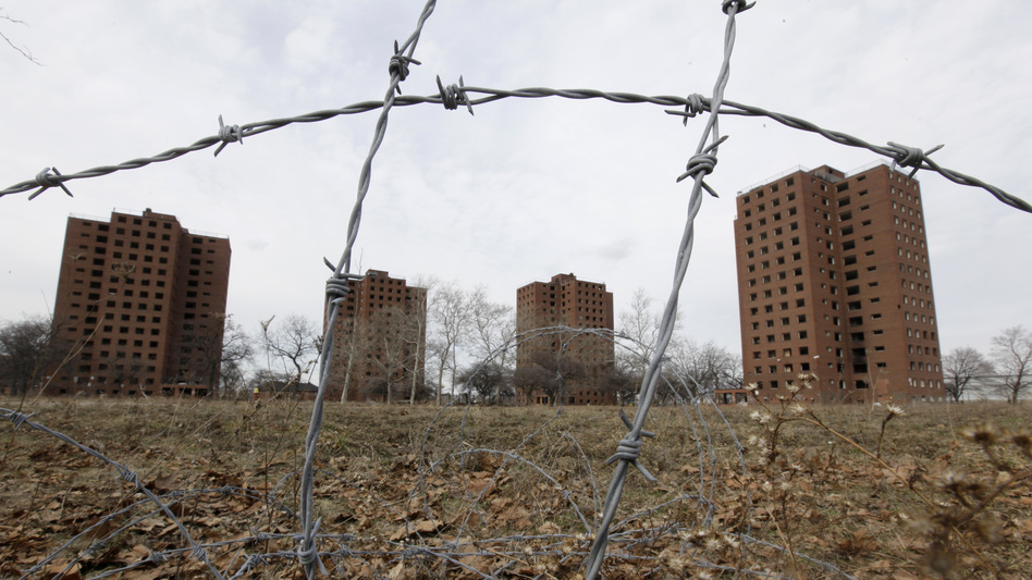 Federal housing policies created after the Depression ensured that African-Americans and other people of color were left out of the new suburban communities — and pushed instead into urban housing projects, such as Detroit's Brewster-Douglass towers. (Paul Sancya/AP)