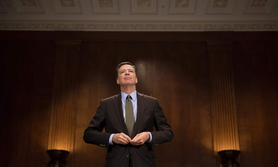 FBI Director James Comey prepares to testify before the Senate Judiciary Committee on Capitol Hill on Wednesday. (Jim Watson/AFP/Getty Images)