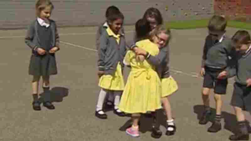 'Is That Your New Pink Leg?!': A Girl Is Embraced As She Shows Off Her Prosthesis