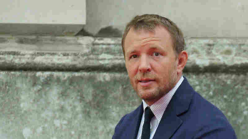 Director Guy Ritchie poses for photographers at Somerset House in central London, on Aug. 7, 2015.