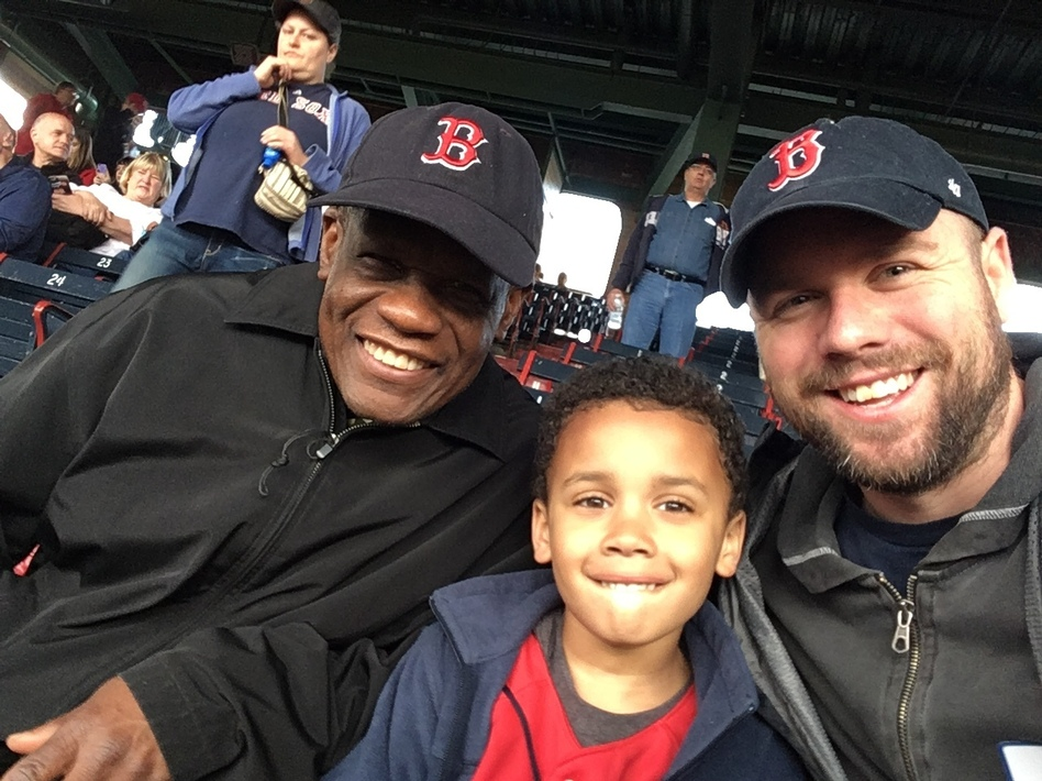Calvin Hennick (right) attends a Red Sox game with his son, Nile, and his father-in-law, Guy Mont-Louis, at Boston's Fenway Park. Hennick reported a white fan who he said made a racist remark about a Kenyan woman who sang the national anthem. (Courtesy of Calvin Hennick)