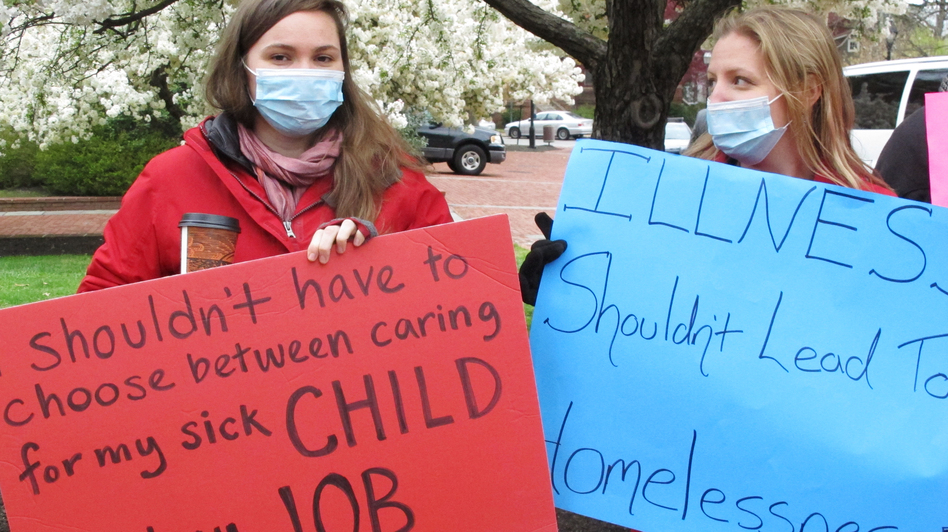 Sandy Robson (left) and Crystal Hall rally for legislation for paid sick leave on April 11, 2016, in Annapolis, Md. Under a bill recently sent to Gov. Larry Hogan, businesses with 15 or more full-time employees would be required to allow workers to earn at least five paid sick days a year. (Brian Witte/AP)