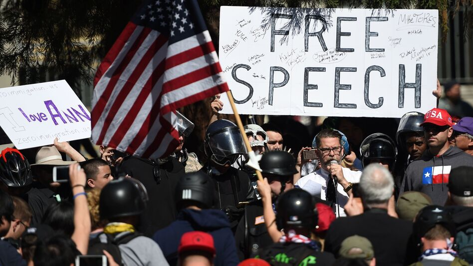 Vice Media co-founder and conservative speaker Gavin McInnes reads a speech written by Ann Coulter to a crowd during a conservative rally in Berkeley, Calif., on April 27. Coulter canceled a planned appearance at the University of California, Berkeley, saying she had lost the backing of the groups that had sponsored her talk. (Josh Edelson /AFP/Getty Images)