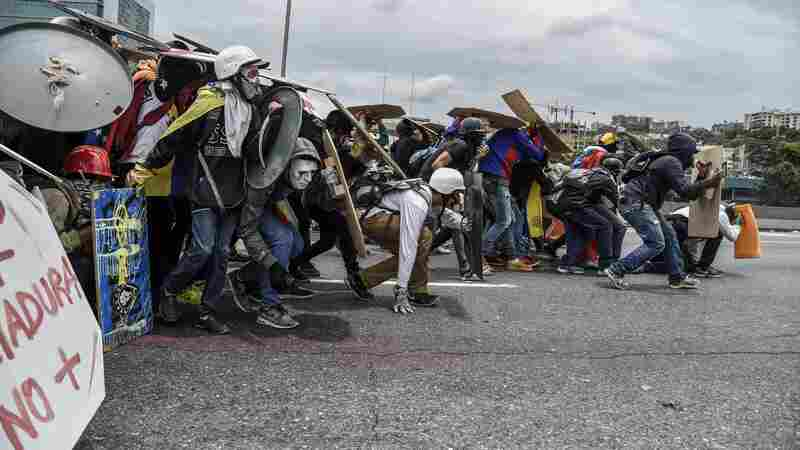 Riven By Fire And Fiery Rhetoric, Venezuela Decides Its Future In The Streets
