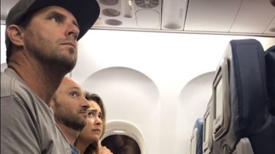Brian Schear, seen here during an argument with Delta staff, says he and his family were forced off a flight from Maui because they put their 2-year-old in a seat Schear had bought for a different child.