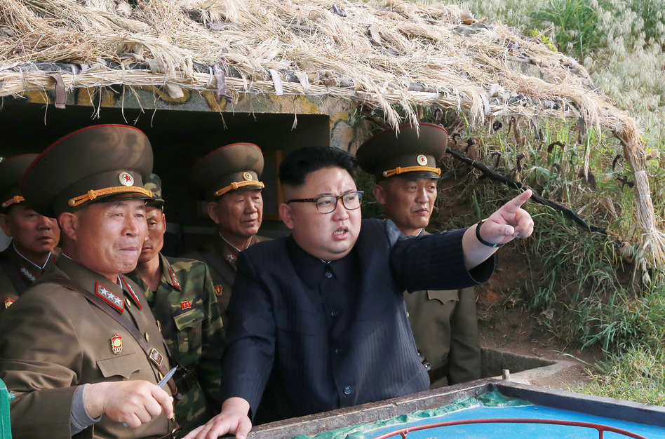 North Korean leader Kim Jong Un (center), inspecting a defense detachment on Jangjae Islet and the Hero Defence Detachment on Mu Islet in a photo published by state media. (AFP/Getty Images)
