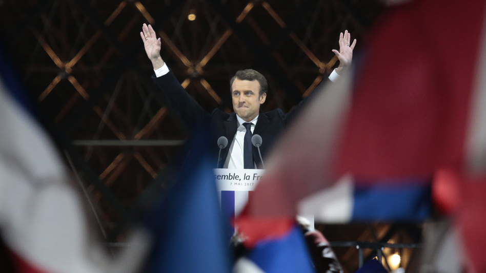 Emmanuel Macron acknowledges supporters at the Louvre on Sunday after winning the French presidential election. Pro-EU centrist Macron defeated far-right rival Marine Le Pen by a comfortable margin. (Patrick Aventurier/Getty Images)