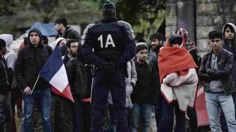 Police Evict Up To 1,600 Migrants From Makeshift Camp In Paris