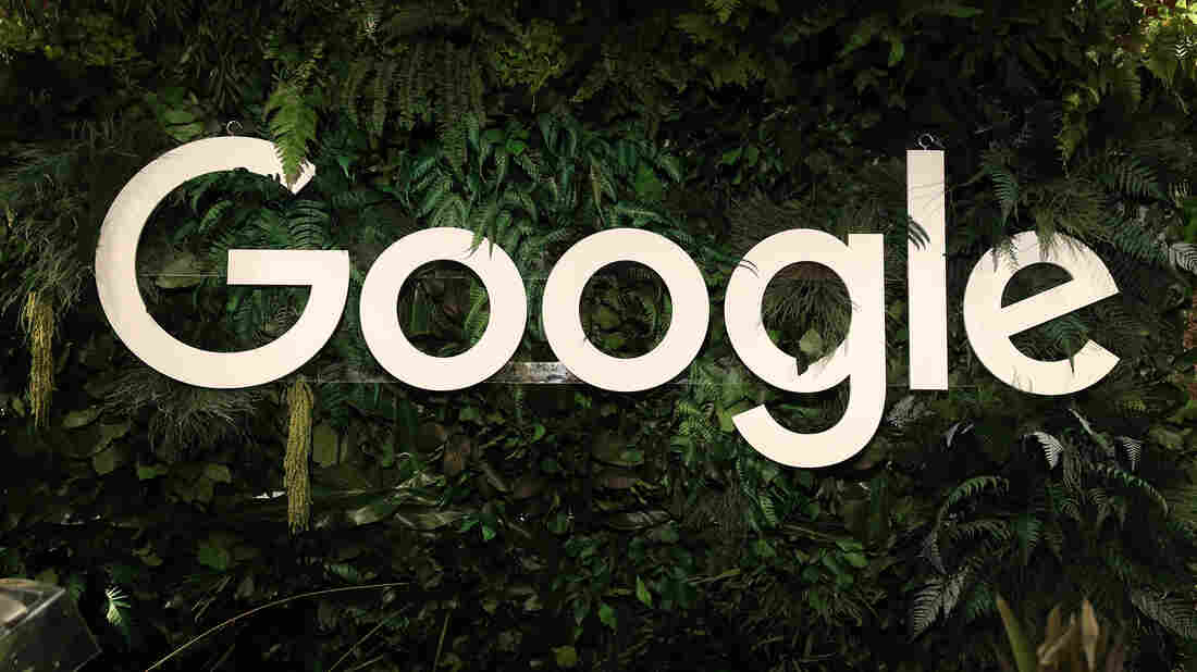 The Google logo hangs among plants at a juice stand in Berlin.