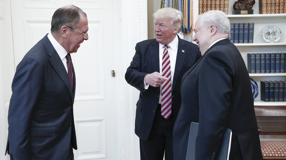 President Trump gestures to Russia's ambassador to the U.S., Sergey Kislyak, as he speaks to Russian Foreign Minister Sergey Lavrov in the Oval Office on Wednesday. (Alexander Shcherbak/TASS/Getty Images)