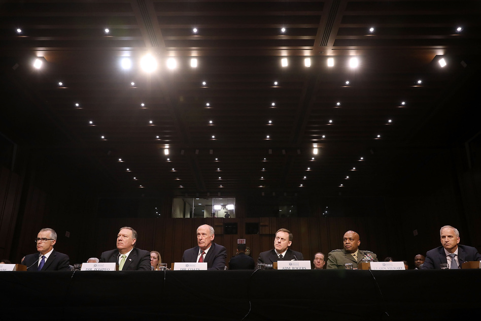 Acting FBI Director Andrew McCabe (from left), Central Intelligence Agency Director Mike Pompeo, Director of National Intelligence Dan Coats, National Security Agency Director Michael Rogers, Defense Intelligence Agency Director Vincent Stewart and National Geospatial-Intelligence Agency Director Robert Cardillo testifiy before the Senate Intelligence Committee. (Chip Somodevilla/Getty Images)