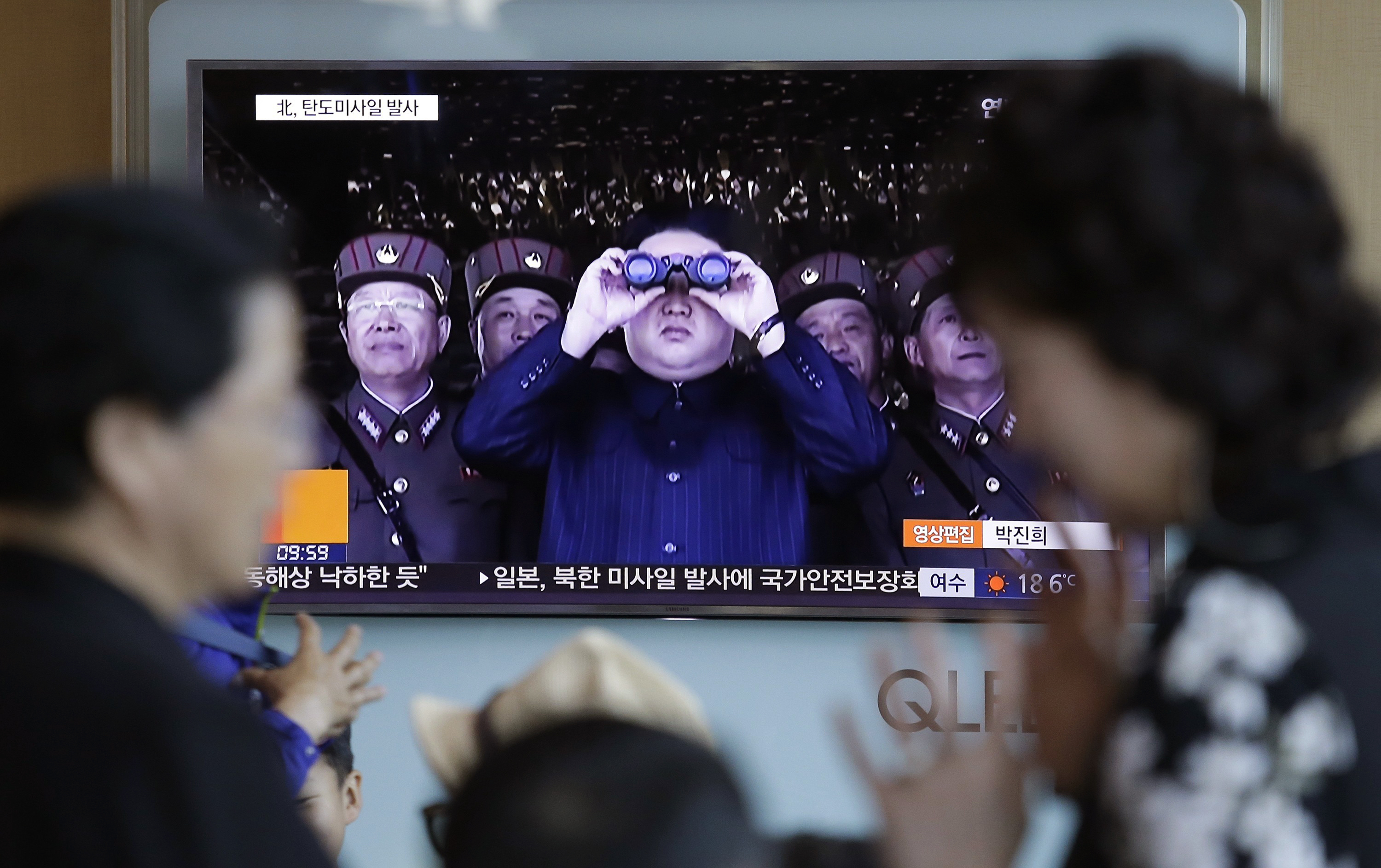 Kim gleeful as North Korea fires longest-range missile