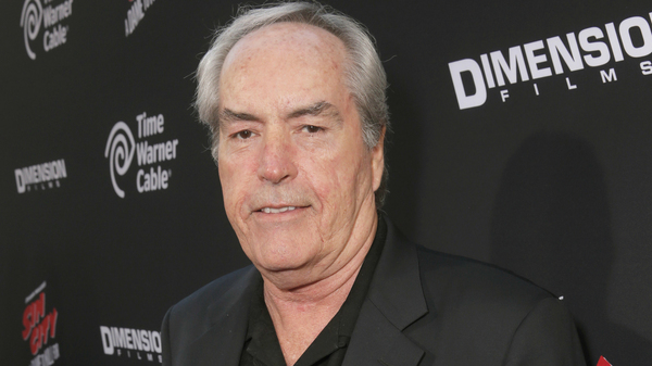 Powers Boothe attends the 2014 Los Angeles premiere of Sin City: A Dame To Kill For. He was an Emmy award for playing cult leader Jim Jones in a 1980 TV movie.