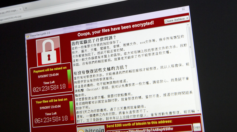 A screenshot of the warning screen from a purported ransomware attack on a laptop in Beijing. (Mark Schiefelbein/AP)