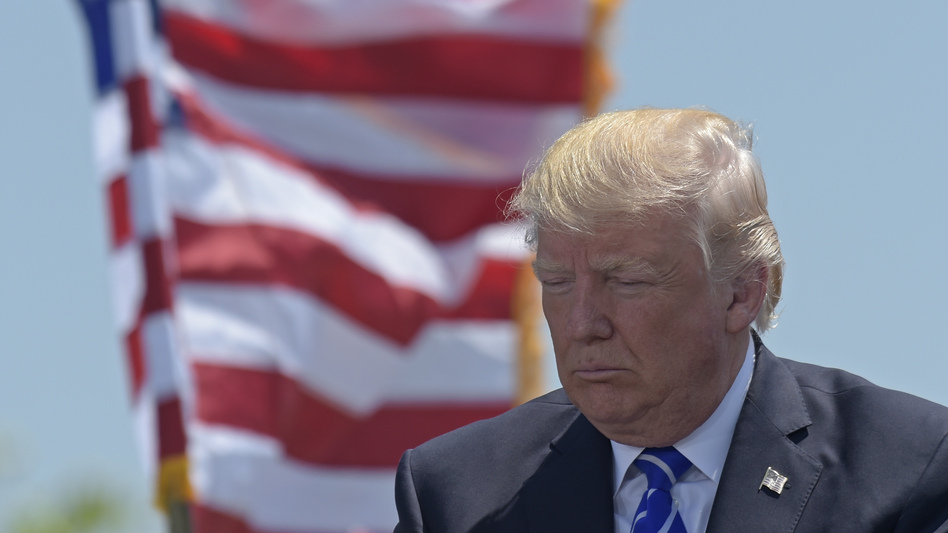 President Trump gives the commencement address at the U.S. Coast Guard Academy in New London, Conn. (Susan Walsh/AP)