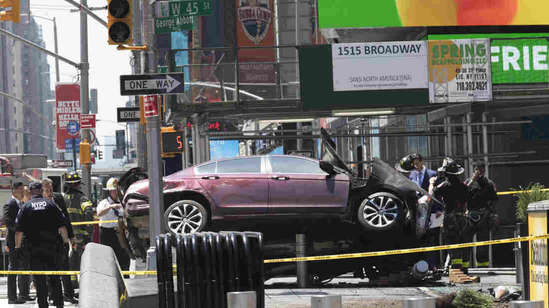 Firefighters Extinguish Blaze After Car Hits Pedestrians at Times Square