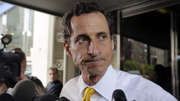 Former New York Rep. Anthony Weiner leaves his apartment building in New York in 2013.