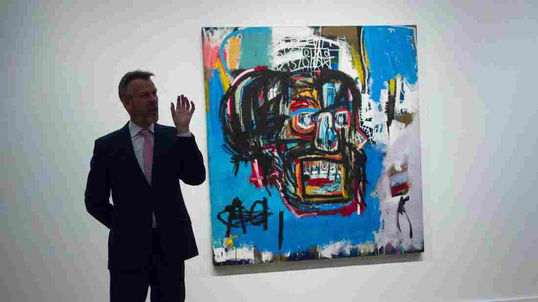 Basquiat painting fetches record $110.5M at Manhattan auction