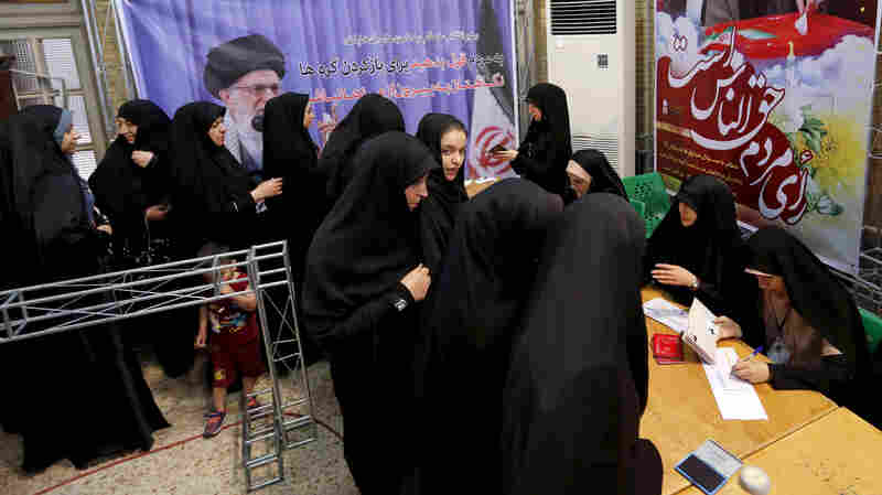 On Election Day, Iran Chooses Between Gradual Reform And Conservative Return