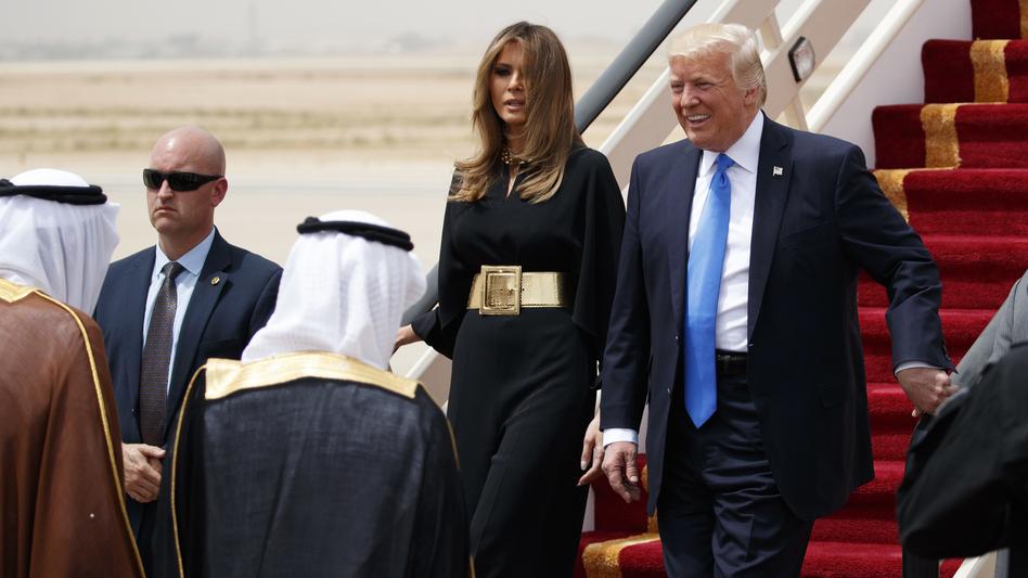 President Donald Trump, accompanied by first lady Melania Trump, smiles at Saudi King Salman, left, upon his arrival in Riyadh, Saudi Arabia.