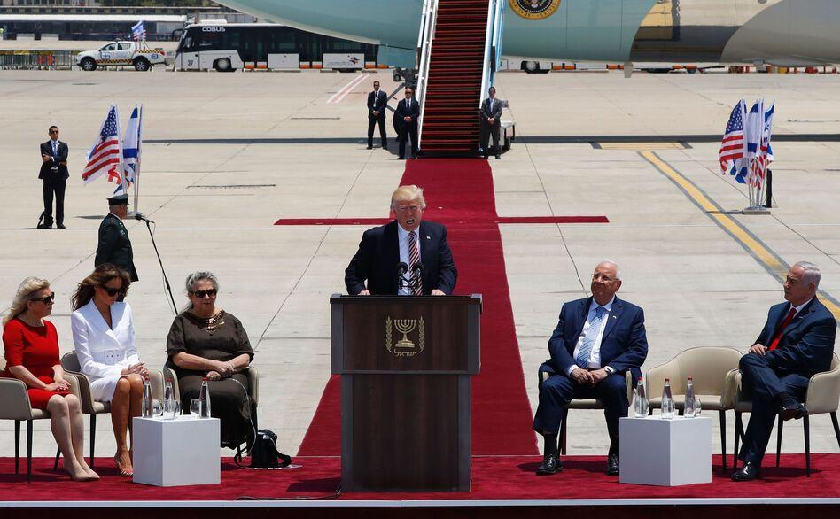 President Trump speaks at a welcome ceremony at Ben Gurion International Airport in Tel Aviv, Israel, on Monday, as Sara Netanyahu (from left), Melania Trump, Nechama Rivlin, Israeli President Reuven Rivlin and Israeli Prime Minister Benjamin Netanyahu listen. (Jack Guez/AFP/Getty Images)