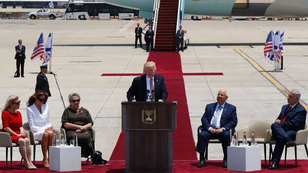 President Trump speaks at a welcome ceremony at Ben Gurion International Airport in Tel Aviv, Israel, on Monday, as Sara Netanyahu (from left), Melania Trump, Nechama Rivlin, Israeli President Reuven Rivlin and Israeli Prime Minister Benjamin Netanyahu listen.