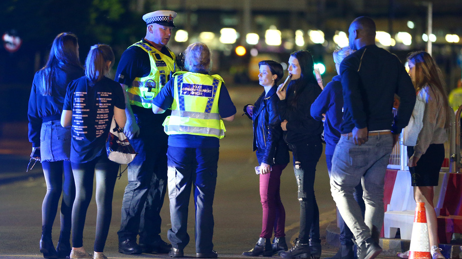 Police and fans outside the Manchester Arena on Monday, following reports of an explosion after Ariana Grande had performed. (Dave Thompson/Getty Images)