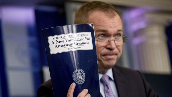 Budget Director Mick Mulvaney holds up a copy of President Donald Trump