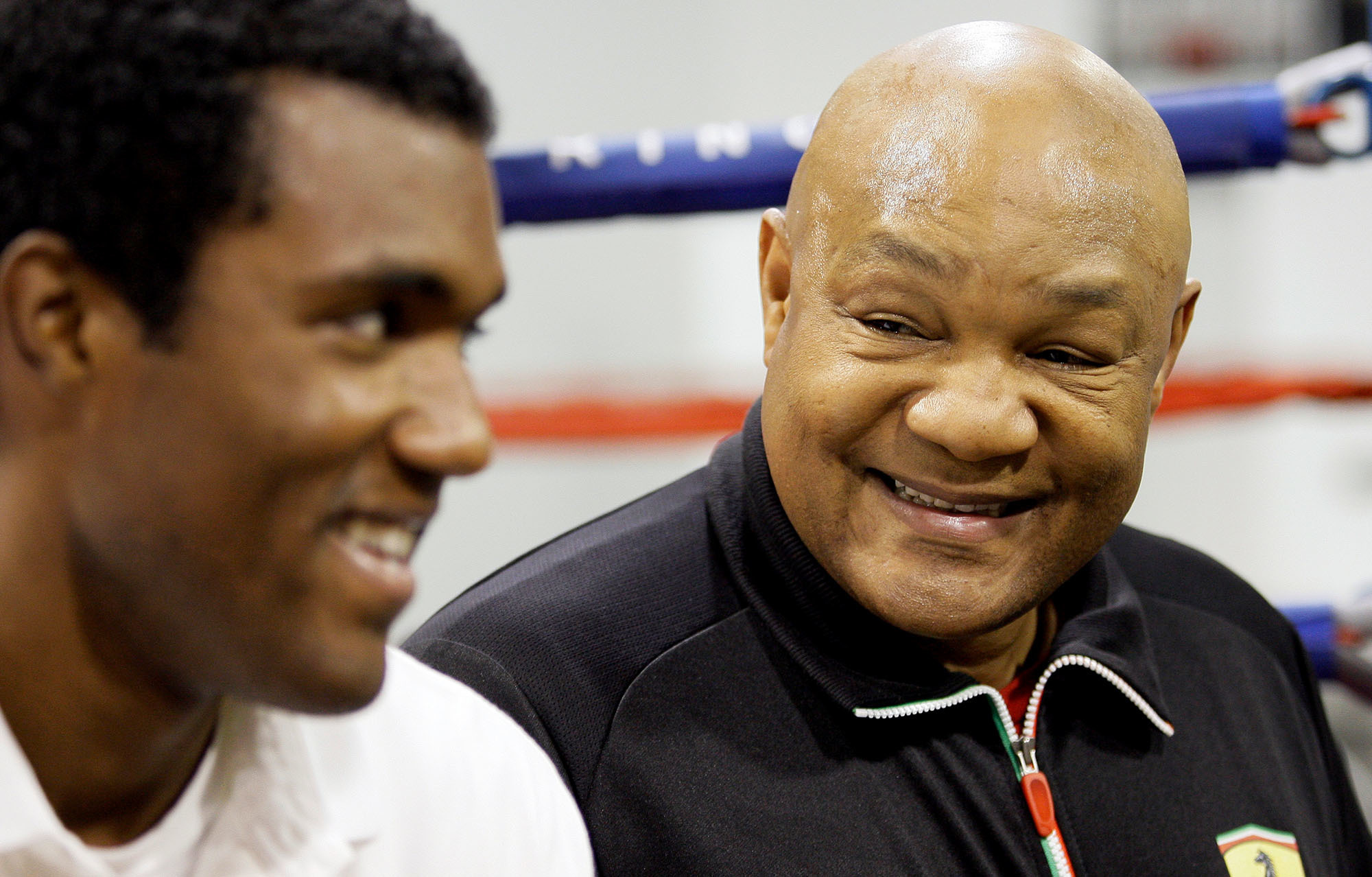 George Foreman (right) smiles as he talks about his son, George Foreman III (left) in Houston in 2009. 'I was too focused on the one-two,' he says of his early days in the ring. (David J. Phillip/AP)