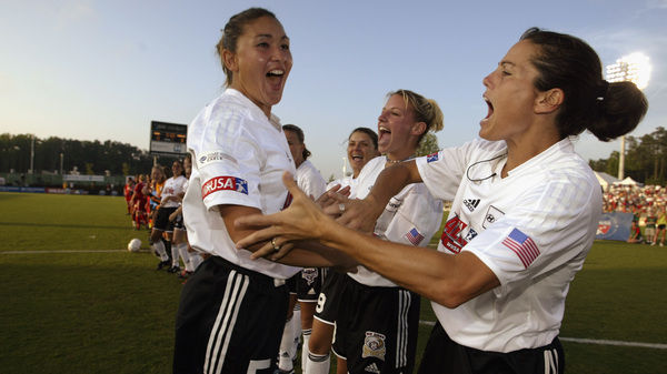 Soccer midfielder Julie Foudy (right) cheers her teammate, Tiffany Roberts, during the WUSA All-Star Game in 2003.