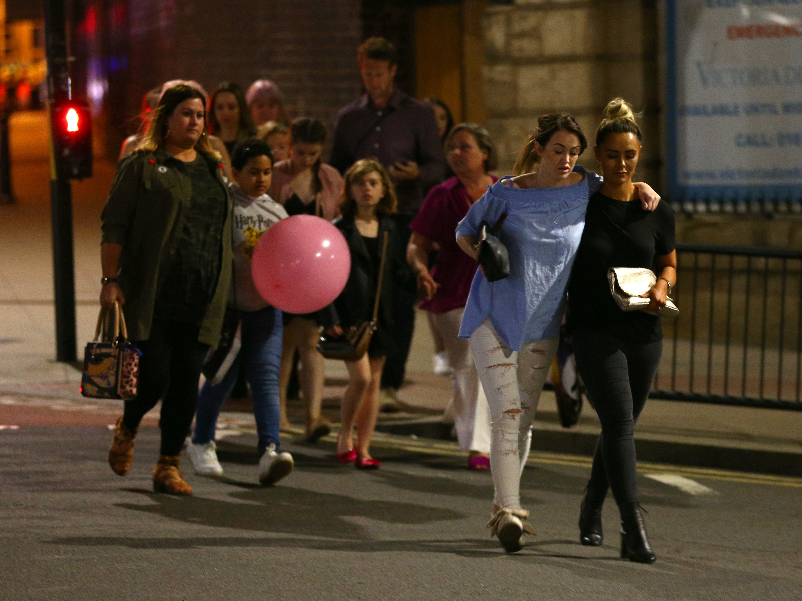 People leave Manchester Arena in England on Monday night following an explosion that killed at least 22 victims and wounded dozens more.     (Dave Thompson/Getty Images)