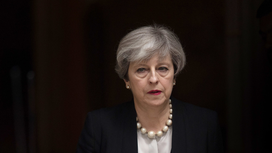 British Prime Minister Theresa May leaves 10 Downing Street after addressing the media in London on Tuesday. (Carl Court/Getty Images)