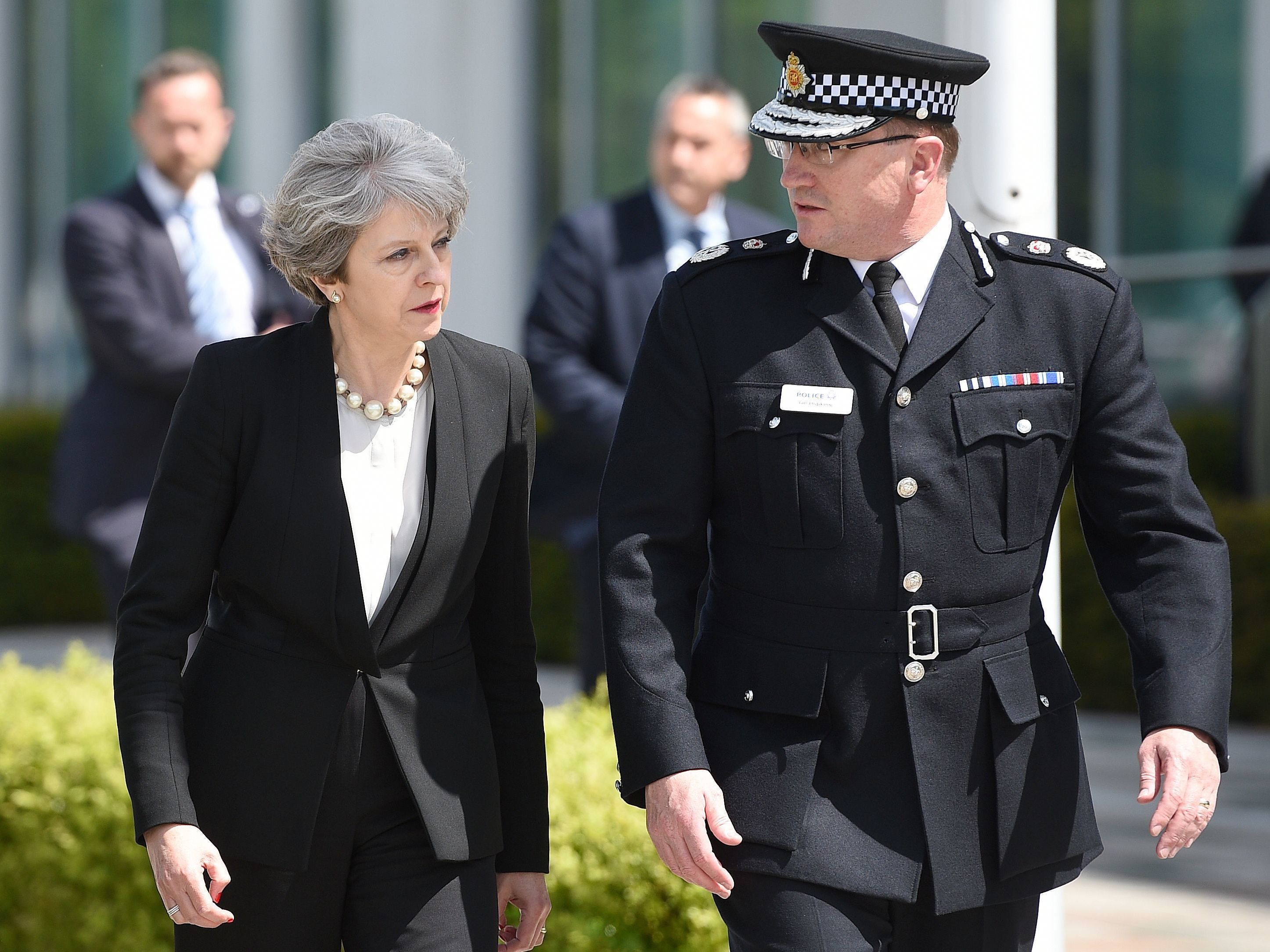 Britain's Prime Minister Theresa May walks with Chief Constable of Greater Manchester Police Ian Hopkins as she arrives at the force's headquarters in Manchester on Tuesday following a deadly terrorist attack the night before. (Oli Scarff/AFP/Getty Images)