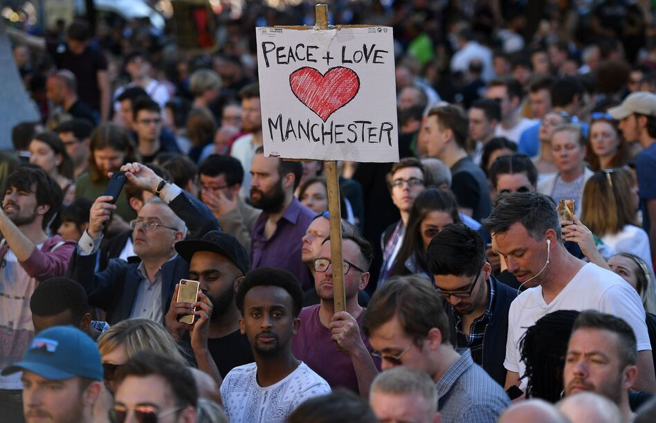 People attend a vigil in Albert Square in Manchester, after the city in northwest England absorbed the worst terror attack on U.K. soil since 2005. (Ben Stansall/AFP/Getty Images)