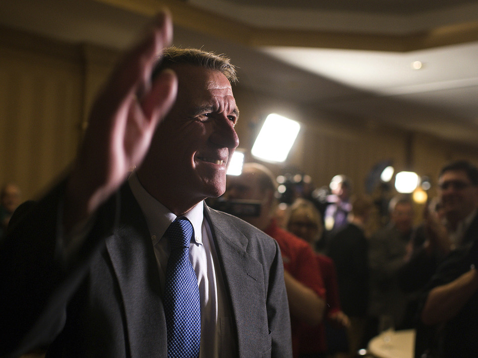 Republican Governor Phil Scott announced Wednesday he would veto the Vermont legislature's bill to legalize recreational marijuana. Above, the governor waves to supporters on election night in November. (Andover/AP)