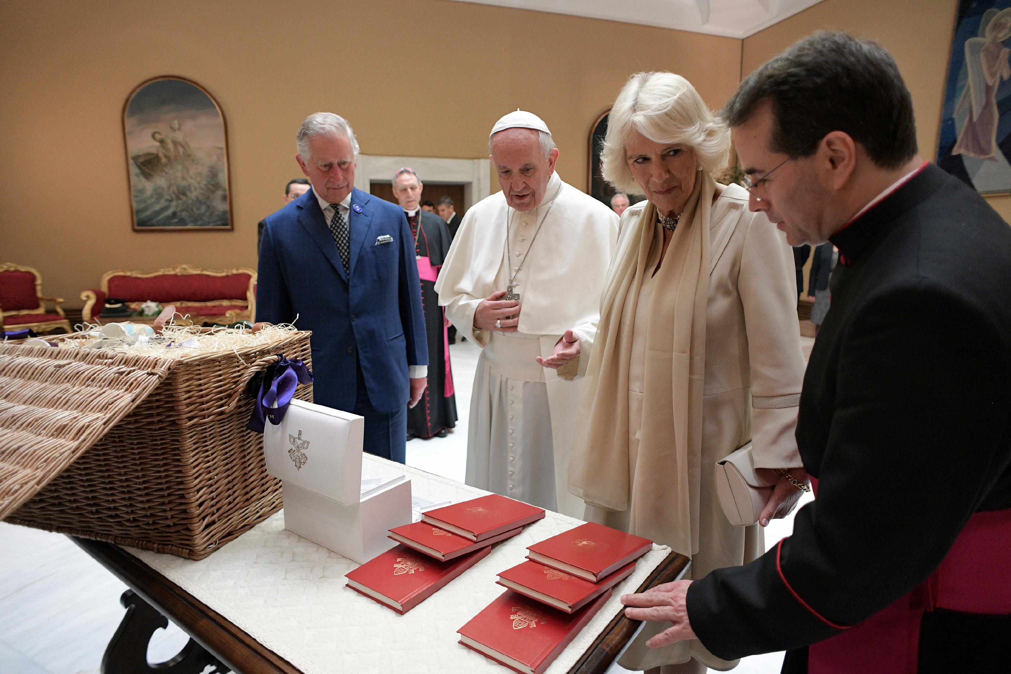 Francis exchanges gifts with Britain's Prince Charles and his wife, Camilla, Duchess of Cornwall, during a private audience at the Vatican last month.     (AP)