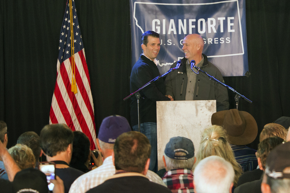 Republican Greg Gianforte (right) welcomes Donald Trump Jr., the president's son, onto the stage at a rally in East Helena, Mont., on May 11. Gianforte, a businessman, is embracing his party's president in his race for the state's open congressional seat. (Bobby Caina Calvan/AP)