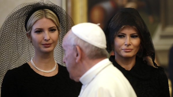 Pope Francis walks past Ivanka Trump, left, and First Lady Melania Trump during a private audience with President Donald Trump at the Vatican Monday.